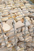 stock photo of rip-rap  - Gabion retaining wall with stacked riprap for wall - JPG