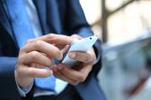 stock photo of lawyer  - Close up of a man using mobile smart phone