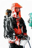 Alpinist facing a harsh blizzard