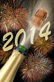 stock photo of sparkling wine  - new year 2014 with popping champagne and firework - JPG