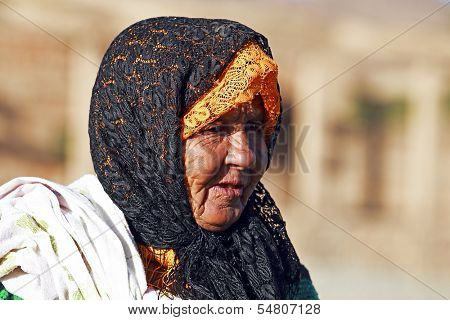 SAHARA DESERT, MOROCCO 19 OCTOBER 2013: Old nomad woman in the Sahara desert, Morocco. Nomadic tribes living in the desert with a traditional lifestyle as a hundred years ago.