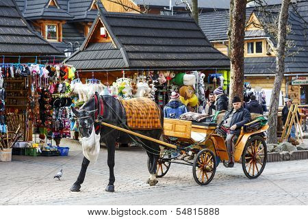 Coachman Waits For Passengers At The Krupowki