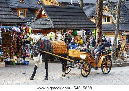 Coachman Waits For Passengers At The Krupowki