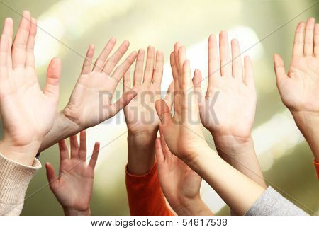 Human hands on bright background
