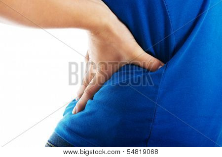 Casual woman is having a back pain. Close up. Isolated on white.