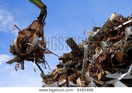 Grabber Loading A Metal Garbage