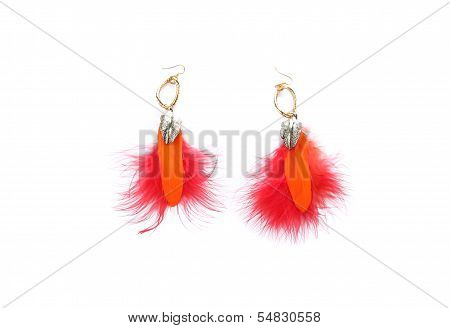 Pair of ladies earrings from orange feather.