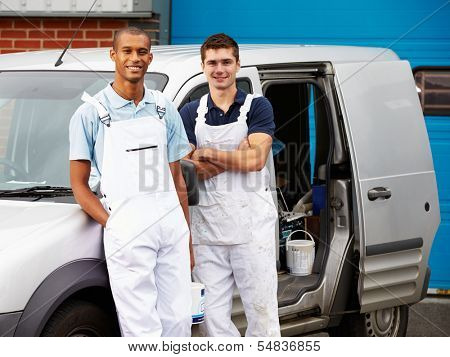Decorators Wearing Overalls Standing Next To Van
