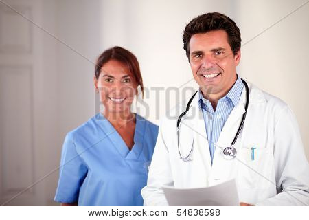 Hispanic Doctor Couple Looking And Smiling At You