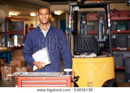 Portrait Of Engineer Standing In Factory