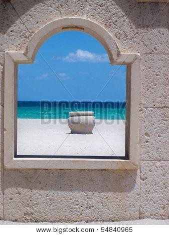 Ocean view with urn through the boardwalk window