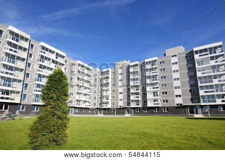 Sixstory apartment building in a residential complex. It is located on the picturesque glade near the village Romashkovo