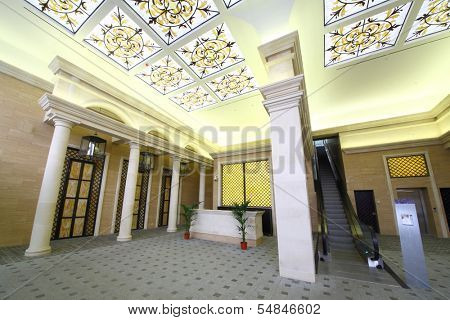 MOSCOW - OCT 11: The elegant front with stained glass ceiling, solemn columns and escalator in the apartment complex Dubrovskaya Sloboda, on October 11, 2013 in Moscow, Russia.