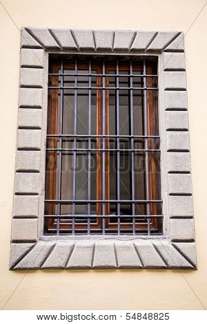 Old Wood Window In Plaster With Iron Bars