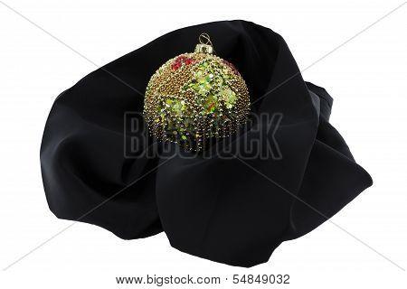 Xmas Ball Cradled On A Black Cloth