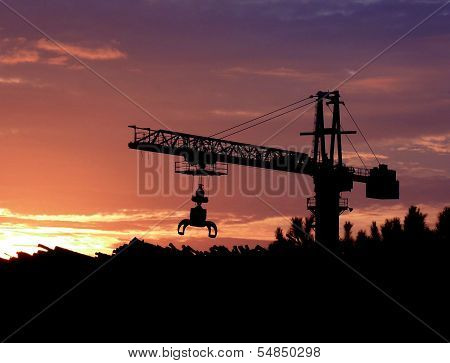 Crane working at sunset
