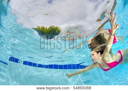 Sexy Woman Swimming Underwater