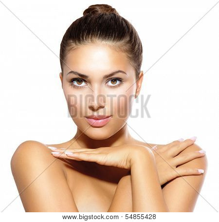 Beauty Spa Woman Portrait. Beautiful Girl Touching her Face. Perfect Fresh Skin. Pure Beauty Model Girl Looking at Camera. Youth and Skin Care Concept. Pampering Skin. Health Care