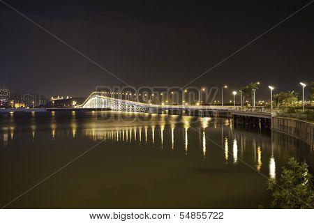 Overwater bridge over the sea at night in Macau.China.