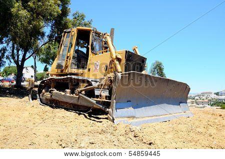 Yellow bulldozer, Andalusia, Spain.