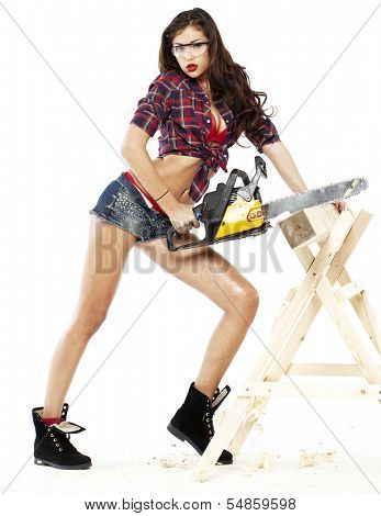 Sexy brunette in a plaid shirt, isolated on gray background