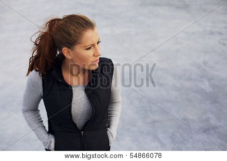 Female Athlete Relaxing After Workout - Outdoors On Beach