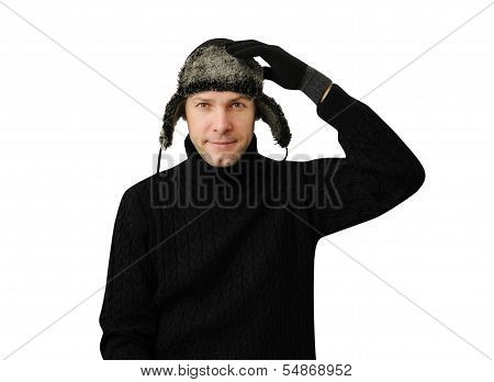 Smiling Man In Black Dressed In Warm Clothes And Cap With Ear-flaps Isolated On The White Background