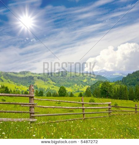 Fence In Mountains Meadow