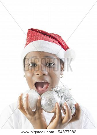 Little girl playing with Christmas decorations