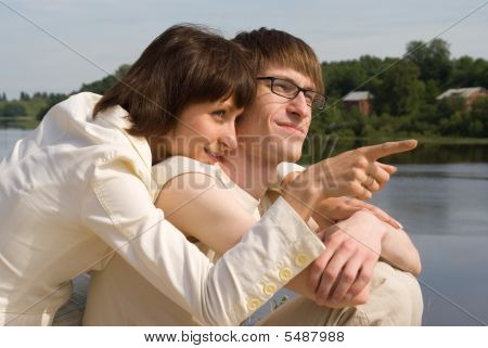 Boy And Girl On The River`s Bank