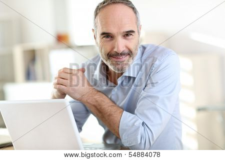Senior businessman working on laptop computer