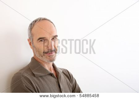 Portrait of 50-year-old man standing on white background