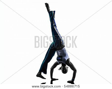 one caucasian woman capoeira dancer dancing in silhouette studio isolated on white background