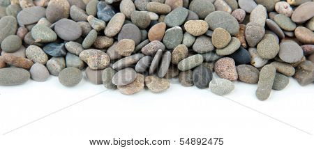 Small sea stones, isolated on white