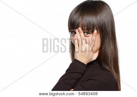 Woman peeking though her fingers