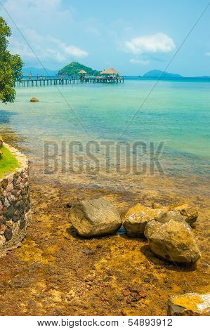 Brown Rock Seashore With Turquoise Color Sea In Maak Island In Trad Province, Thailand