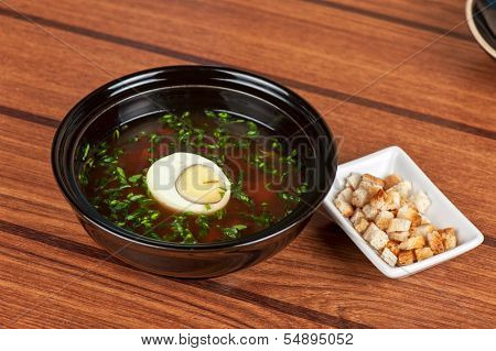 Traditional Russian kvass soup with vegetables - okroshka with rusks