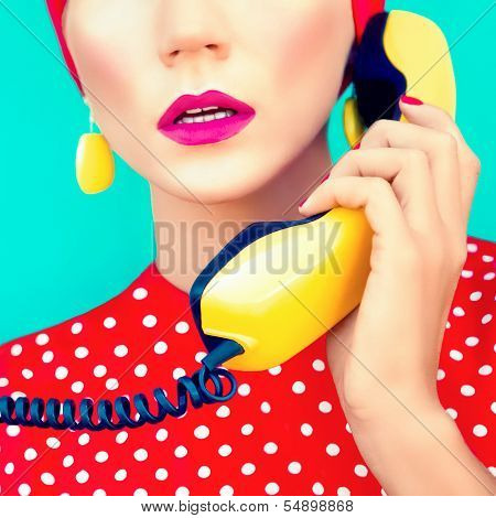 close-up portrait of a retro girl with telephone