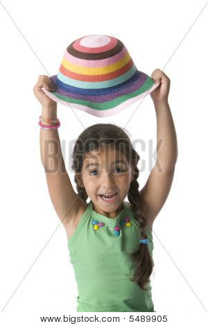 Little Girl Is Raising Her Colored Hat For Fun