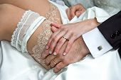 stock photo of garter  - Married couple with golden rings and garter - JPG