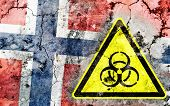 stock photo of biohazard symbol  - Old cracked wall with biohazard warning sign and painted flag flag of Norway - JPG