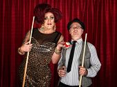 stock photo of drag-queen  - Drag queen holding pool balls with surprised man - JPG