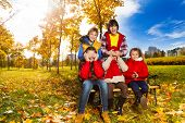 foto of guess  - Friends and surprise guess who action with boys hiding girls face with palms in autumn park - JPG