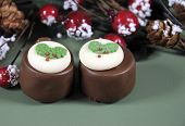Festive Christmas Food, Plum Pudding Decorated Chocolates In Holiday Green Background With Selective