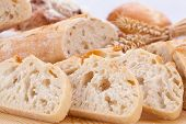 stock photo of baguette  - fresh tasty mixed bread slice bakery loaf objects food - JPG