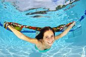 Girl Swimming Underwater With A Scarf