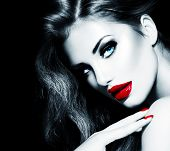 Sexy Beauty Girl with Red Lips and Nails. Provocative Make up. Luxury Woman with Long Hair. Fashion