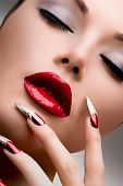 Fashion Model Girl Face. Makeup and Manicure. Red Long Nails and Red Glossy Lips. Sensual Mouth. Nai