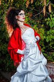picture of carnal  - Attractive bride in a wedding dress with bright makeup red shawl - JPG