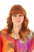 Portrait of beautiful red haired girl with colorful blouse
